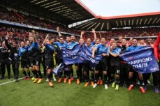 The boys celebrating on the pitch at The Valley